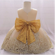 Dress with a gold bow