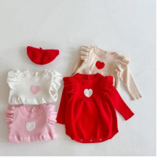 Knitted bodysuit with ruffles and a heart